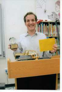 "June, 2012: receiving my ""Apple"" for winning Teacher of the Year, the first to say Hubert O. Sibley K-8 Academy"